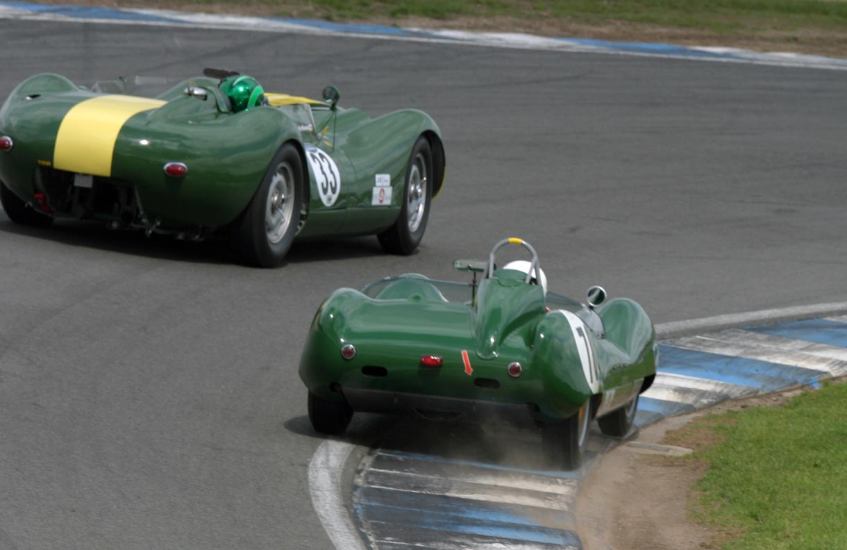 Here you see Dion Kremer squeezing past Martin Stretton's 3.8L Lister Jaguar