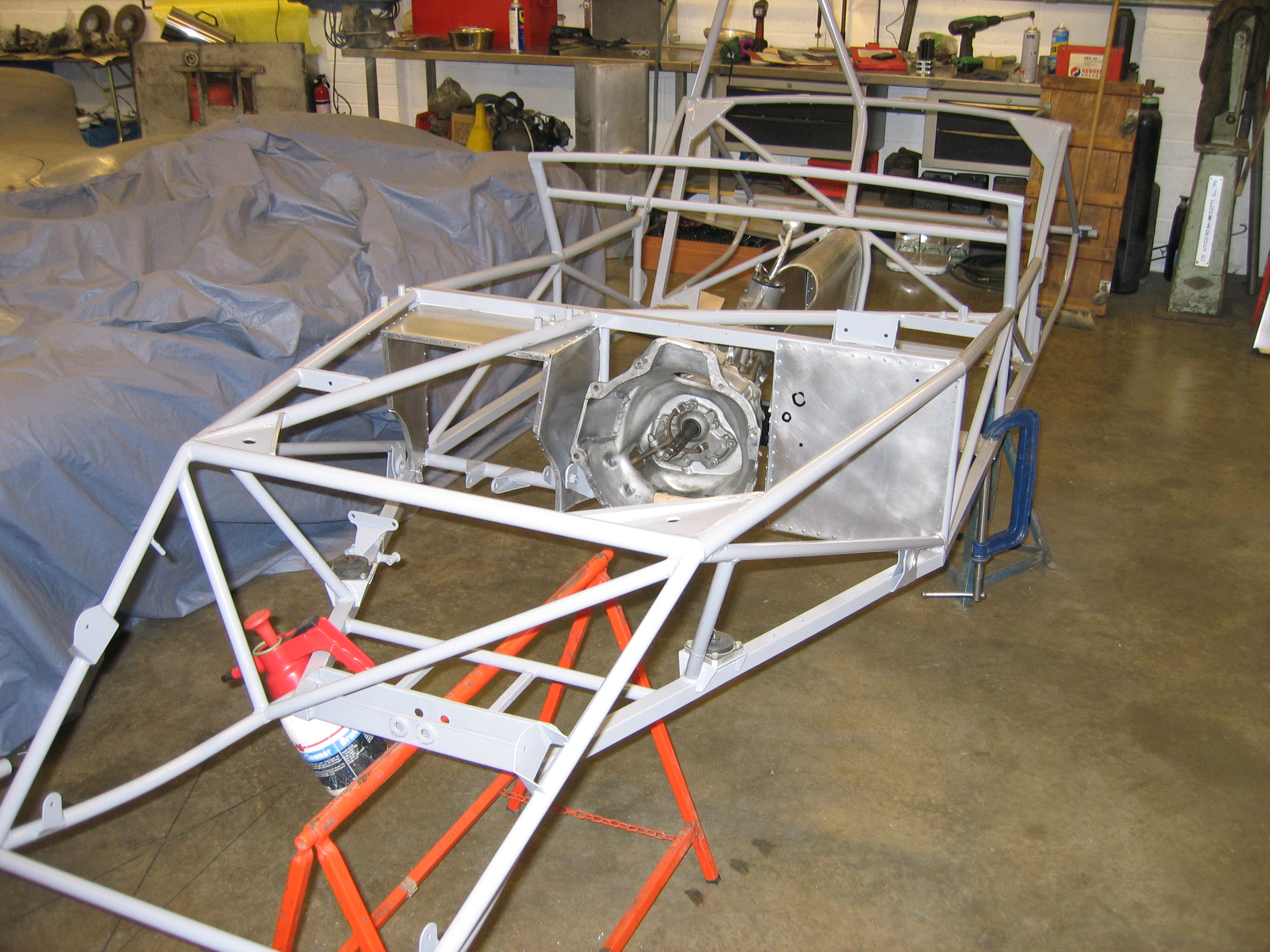 A new Lotus 11 chassis being assembled